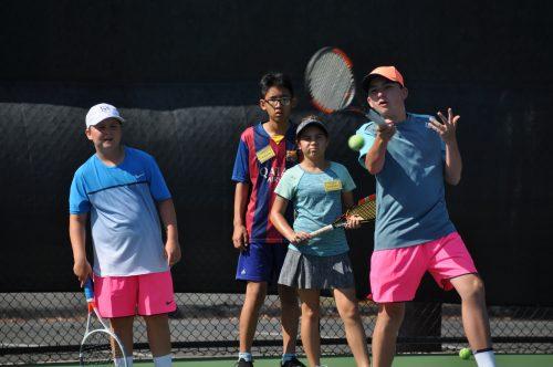 Junior playing tennis academy